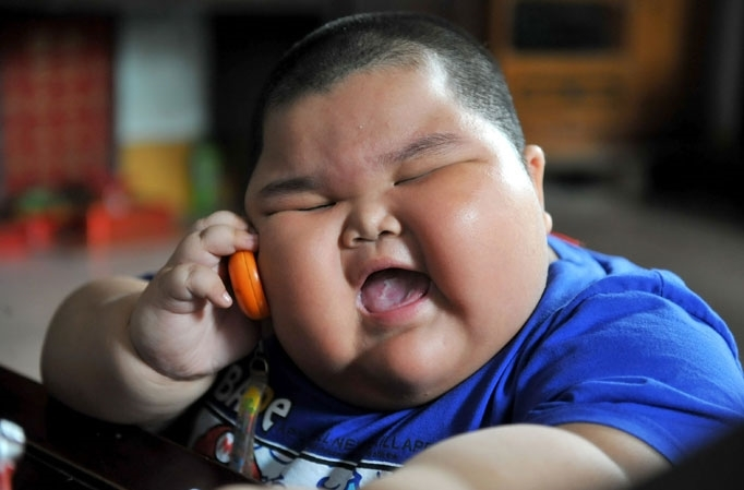 Fat kid on phone