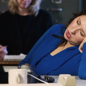 WOMEN SLEEPING AT WORK