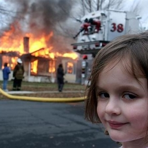 Girl with house on fire in the background