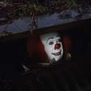 Pennywise the creepy sewer clown.