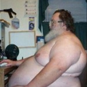 Fat guy at computer