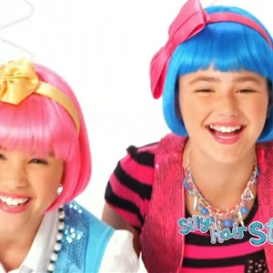 Gracie Haschak & Her Friend Smiling In Lalaloopsy Harmony B. Sharp Commercial