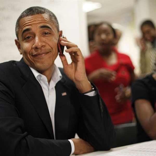 smiling obama on the phone