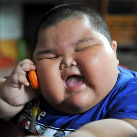 Fat asian kid on phone