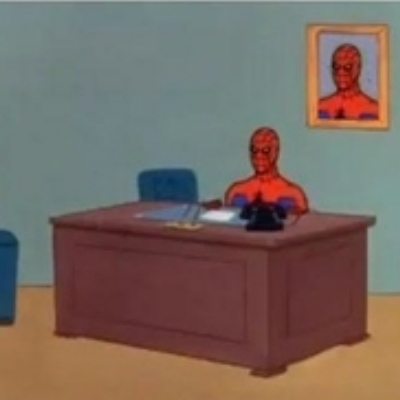 60s spiderman behind desk