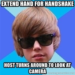 Just Another Justin Bieber - EXTEND HAND FOR HANDSHAKE HOST TURNS AROUND TO LOOK AT CAMERA
