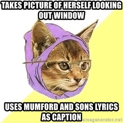 Hipster Kitty - Takes Picture of herself looking out window Uses Mumford and Sons Lyrics as caption