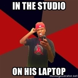 wannabe rapper - in the studio on his laptop