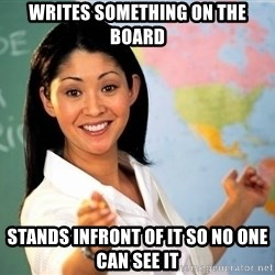 Unhelpful High School Teacher - writes something on the board stands infront of it so no one can see it