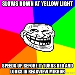 Trollface - slows down at yellow light speeds up before it turns red and looks in rearview mirror