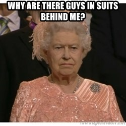 Unimpressed Queen - Why are there guys in suits behind me?