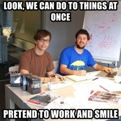 Naive Junior Creatives - look, we can do to things at once pretend to work and smile