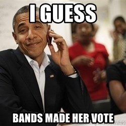 smiling obama on the phone - i guess bands made her vote