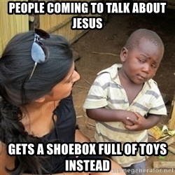 skeptical black kid - People coming to talk about jesus Gets a shoebox full of toys instead