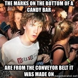 Sudden Realization Ralph - the marks on the bottom of a candy bar are from the conveyor belt it was made on