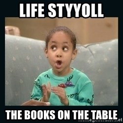 Raven Symone - life styyoll  the books on the table