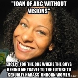"Adria Richards - ""Joan of Arc without visions"" except for the one where the guys behind me travel to the future to sexually harass  unborn women"