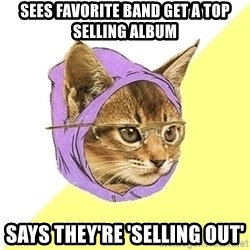 Hipster Kitty - sees favorite band get a top selling album says they're 'selling out'