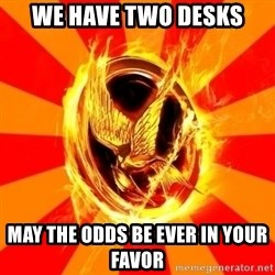 Typical fan of the hunger games - we have two desks may the odds be ever in your favor
