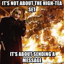 The Joker Sending a Message - IT'S NOT ABOUT the high-tea set  It's about sending a message