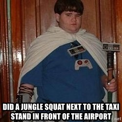 Fat nerd -  did a jungle squat next to the taxi stand in front of the airport