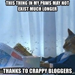 newspaper cat realization - this thing in my paws may not exist much longer thanks to crappy bloggers