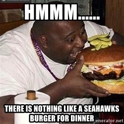 Fat man eating burger - hmmm...... there is nothing like a Seahawks burger for dinner