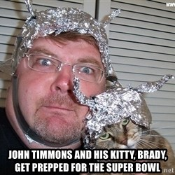 conspiracy nut -  John Timmons and his kitty, Brady, get prepped for the Super Bowl