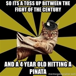 Frustrated Journalist Cat - So its a toss up between the fight of the century and a 4 year old hitting a pinata