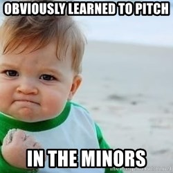 fist pump baby - OBVIOUSLY LEARNED TO PITCH IN THE MINORS