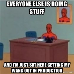 60s spiderman behind desk - everyone else is doing stuff and i'm just sat here getting my wang out in production