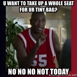 Dikembe Mutombo - u want to take up a whole seat for ur tiny bag? No No No not today