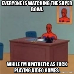 60s spiderman behind desk - everyone is watching the super bowl while i'm apathetic as fuck playing video games.