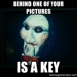 SAW - I wanna play a game - behind one of your pictures is a key