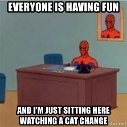 60s spiderman behind desk - everyone is having fun and i'm just sitting here watching a cat change