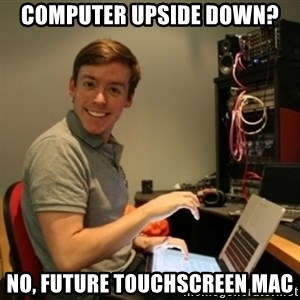 Ridiculously Photogenic Journalist - Computer upside down? No, future touchscreen mac