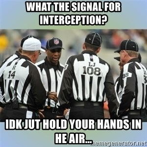 NFL Ref Meeting - What the signal for interception? Idk jut hold your hands in he air...