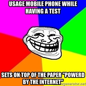 Trollface - usage mobile phone while having a test sets on top of the paper ''powerd by the internet''
