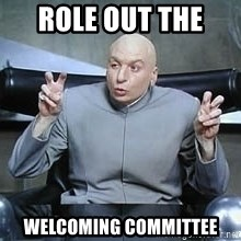 Dr. Evil finger quotes - role out the  Welcoming committee