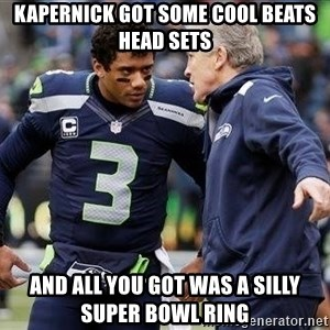 Russell Wilson and Pete Carroll - Kapernick got some cool Beats head sets and all you got was a silly Super Bowl ring