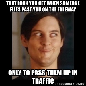 Toby Maguire trollface - That look you get when someone flies past you on the freeway Only to pass them up in traffic