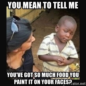 African little boy - You mean to tell me You've got so much food you paint it on your faces?