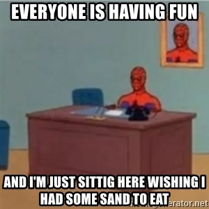 60s spiderman behind desk - everyone is having fun and i'm just sittig here wishing i had some sand to eat