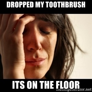 crying girl sad - dropped my toothbrush its on the floor