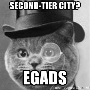 Monocle Cat - SECOND-TIER CITY? EGADS