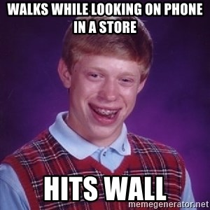 Bad Luck Brian - walks while looking on phone in a store hits wall