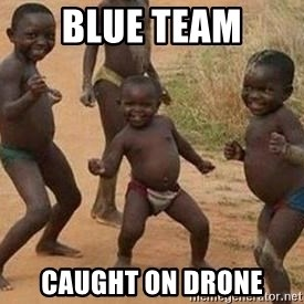 african children dancing - Blue team caught on drone