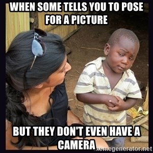 Skeptical third-world kid - When some tells you to pose for a picture But they don't even have a camera
