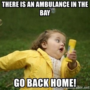 Little girl running away - There is an ambulance in the bay Go back home!
