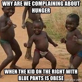 african children dancing - why are we complaining about hunger when the kid on the right with blue pants is obese